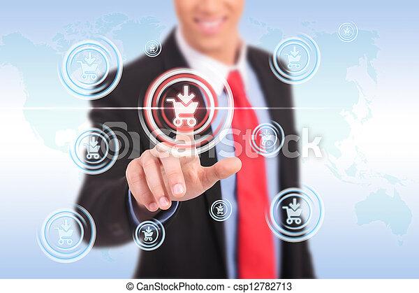 business man push shopping button - csp12782713