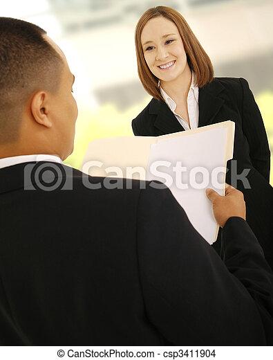 Business Man Reviewing Subordinate Work - csp3411904