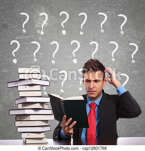 business man scratching his head while reading - csp12601768