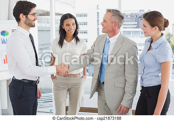 Business man shaking colleagues hand - csp21873188