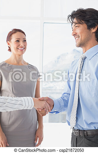 Business man shaking colleagues hand - csp21872050