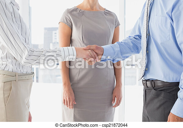 Business man shaking colleagues hand - csp21872044