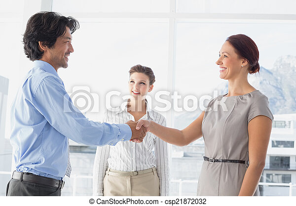 Business man shaking colleagues hand - csp21872032
