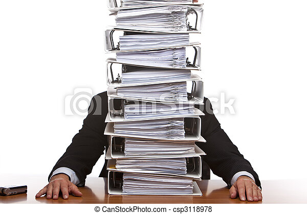 Business man sits in front of huge paperwork (folders) - csp3118978