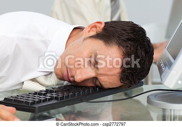 Business man sleeping at his desk in the office picture ...