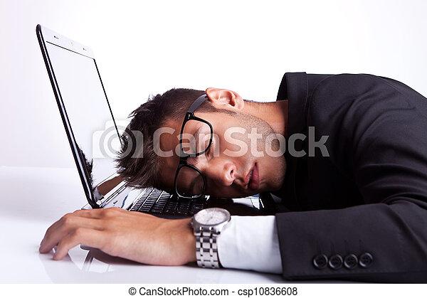 Business man sleeping on a laptop computer - csp10836608