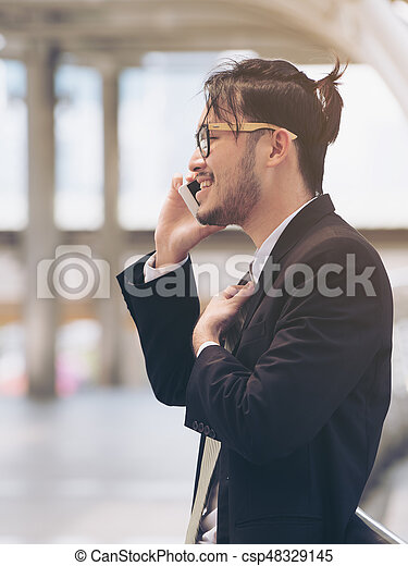 Business Man Speaking on the Phone - csp48329145