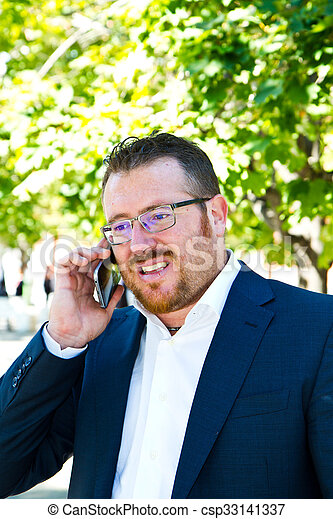 Business man speaking on the phone - csp33141337