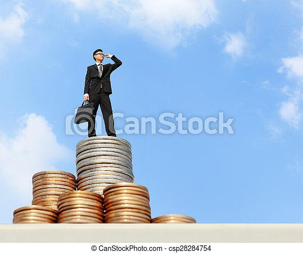 business man stand on money - csp28284754