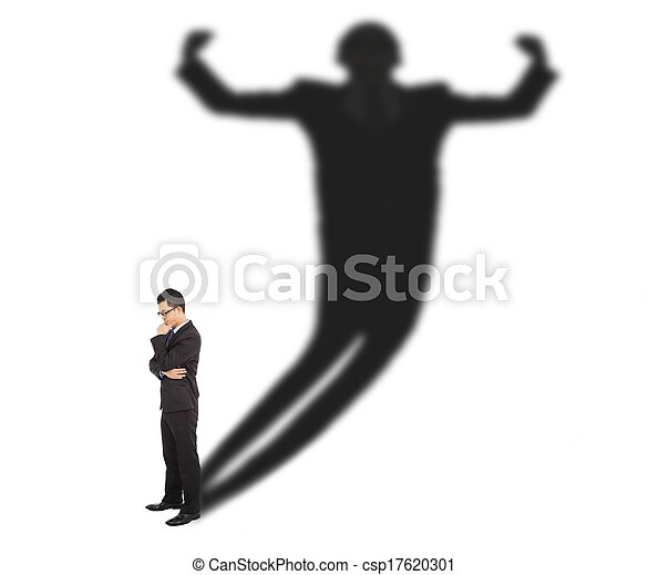 Business man standing and casting shadow of a strong man  - csp17620301