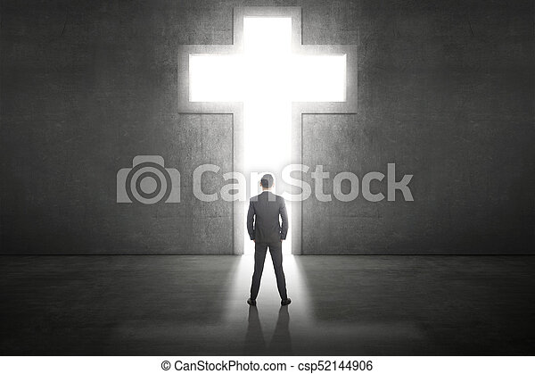 Business man standing in front of the shining cross - csp52144906