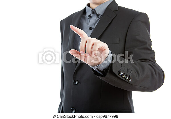 Business man touching an imaginary screen against white background - csp9677996