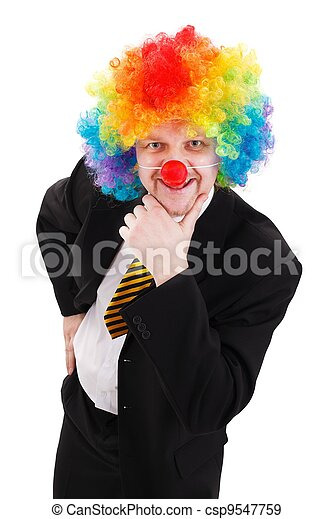 Business man wearing colorful clown wig - csp9547759