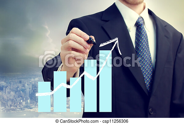 Business Man with Chart Showing Growth - csp11256306