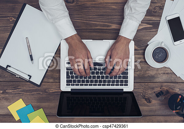 Business man working in the office using laptop - csp47429361