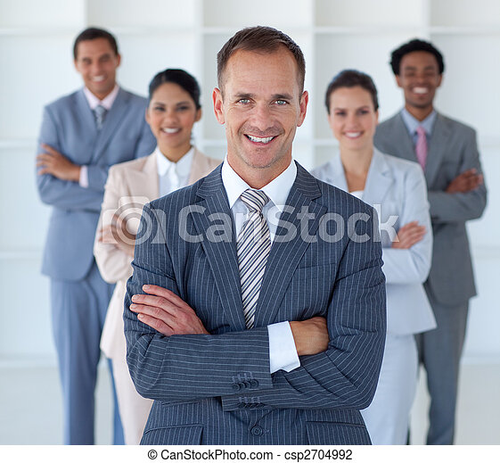 Business manager standing in office leading his team - csp2704992