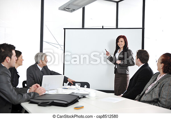 Business meeting - group of people in office at presentation - csp8512580