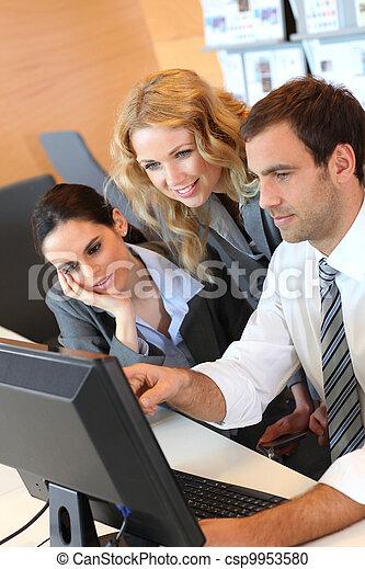 Business meeting in front of desktop computer - csp9953580