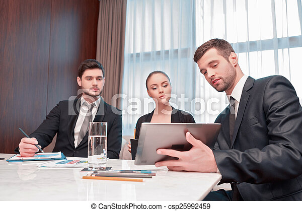 Business meeting with colleagues - csp25992459