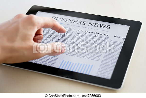 Business News On Tablet PC - csp7256083