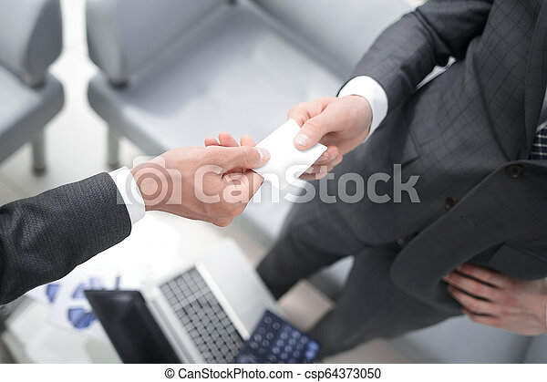 business partners exchanging business cards - csp64373050