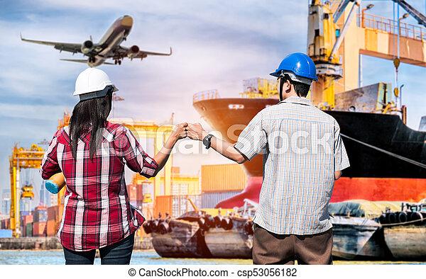 Business partners giving fist bump after business shipping logistics successful. Partnership business concept,Business teamwork concept. - csp53056182