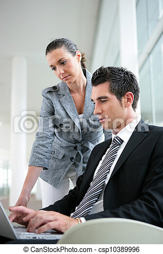 Business partners in foyer with laptop - csp10389996