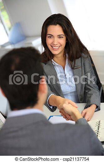 Business partners shaking hands after meeting - csp21137754