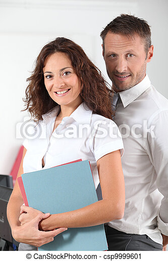 Business partners standing in the office - csp9999601