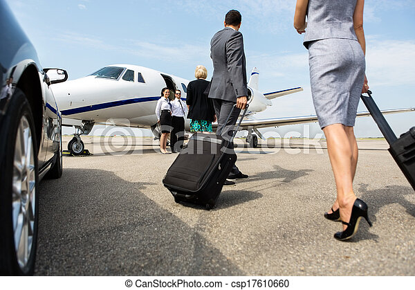 Business Partners Walking Towards Private Jet - csp17610660