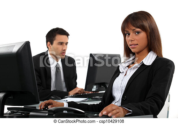 Business partners working on computers - csp10429108