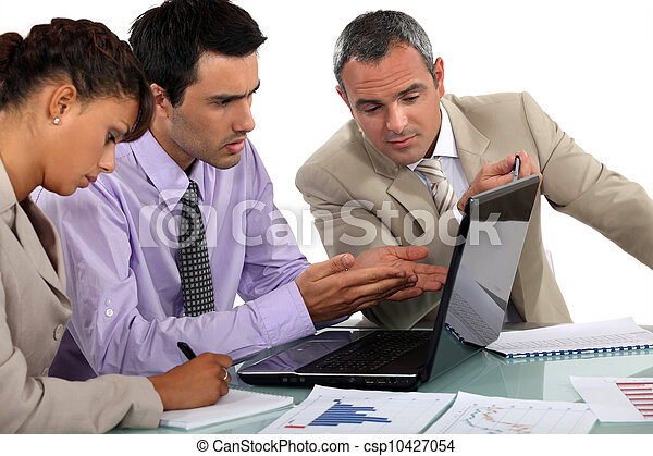 Business people at a laptop - csp10427054