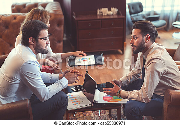 Business people at meeting - csp55336971