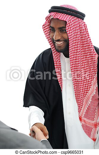 Business people at Middle East shaking hands - csp9665031
