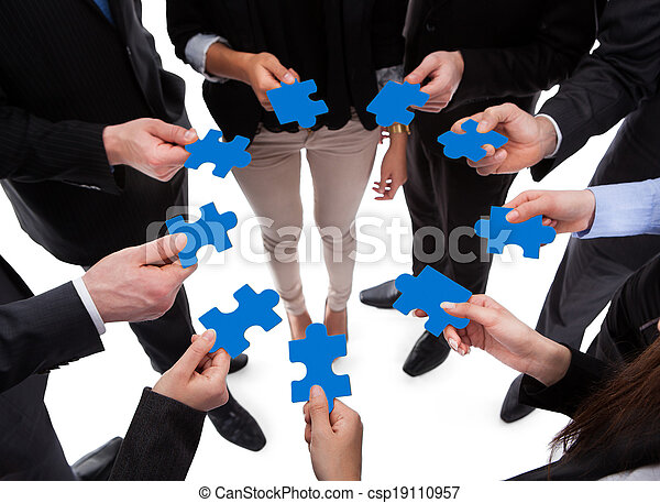 Business people connecting puzzle pieces - csp19110957