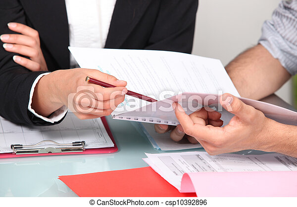 Business people discussing a document - csp10392896
