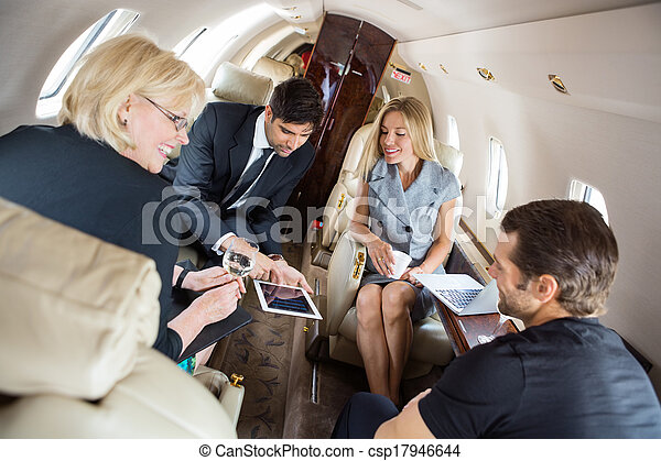 Business People Discussing In Corporate Jet - csp17946644