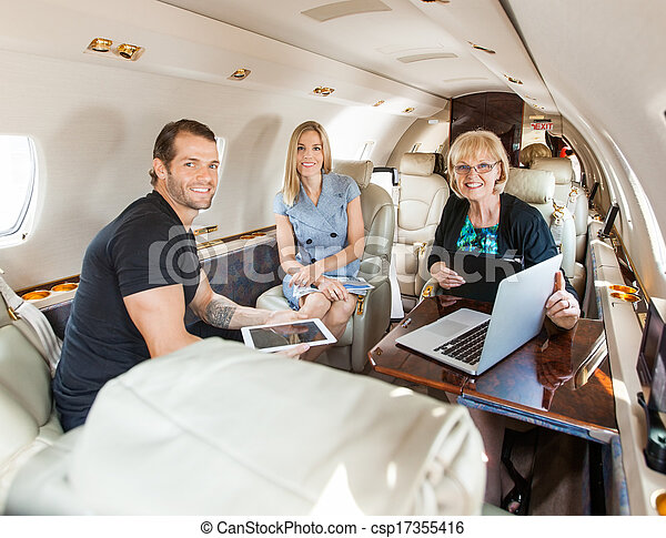 Business People Discussing In Private Jet - csp17355416