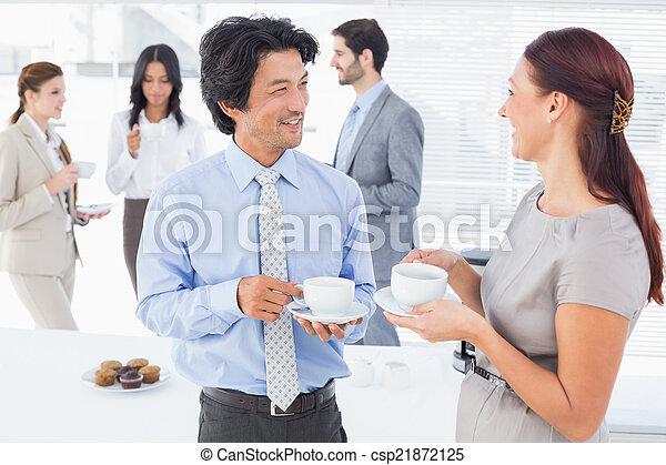 Business people enjoying their drinks - csp21872125