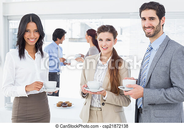 Business people enjoying their drinks - csp21872138