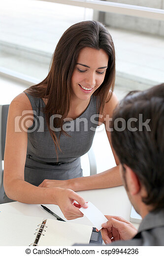 Business people exchanging business card - csp9944236