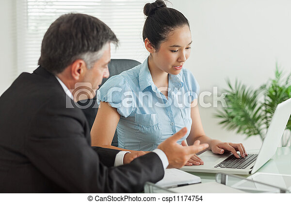 Business people explaining something to each other - csp11174754