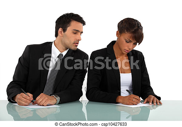 Business people filling in a form - csp10427633