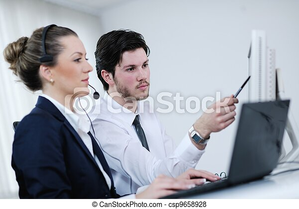 business people group working in customer and help desk office - csp9658928