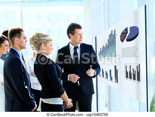 Business people having on presentation at office. Businessman presenting on glassboard. - csp15463790