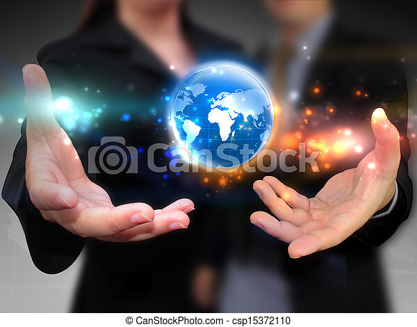 Business people holding business world - csp15372110