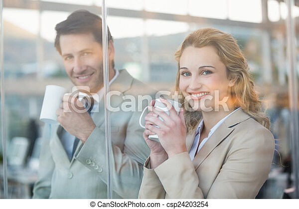 Business people holding cup  - csp24203254