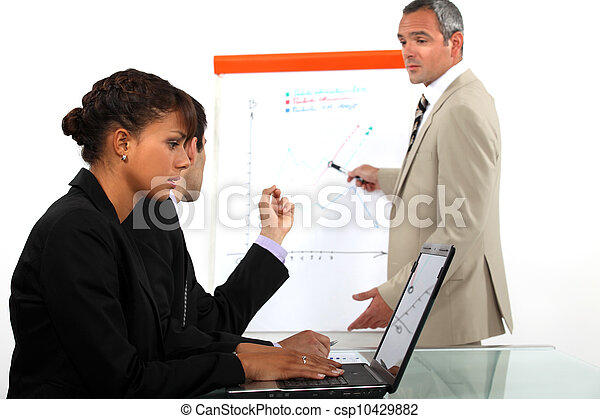 Business people in a meeting - csp10429882