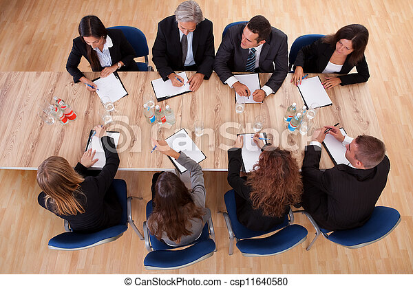 Business people in a meeting - csp11640580
