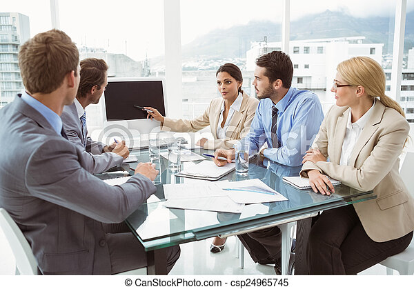 Business people in board room - csp24965745